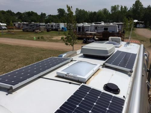 Skylights installed on a trailer with solar panels
